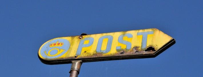 Et gammelt skilt for Posten i Sverige.